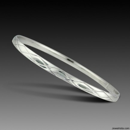 Silver Quilted Oval Bangle By Charles Garnier