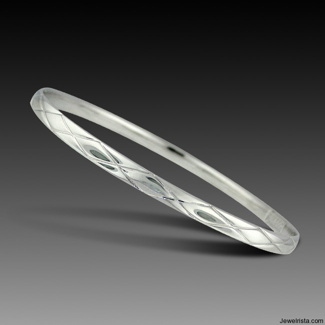 Silver Quilted Oval Bangle By Jewelry Designer Charles Garnier